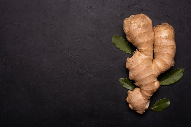 Large ginger root isolated on black
