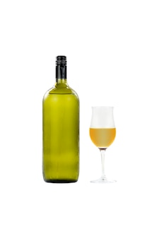 Large glass wine bottle and wine glass isolated on white background.