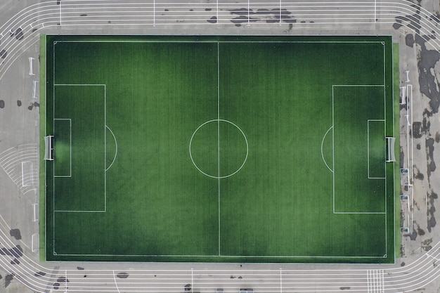 Large green football field at stadium closeup