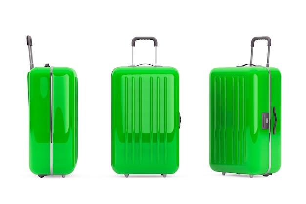 Большие зеленые чемоданы из поликарбоната на белом фоне