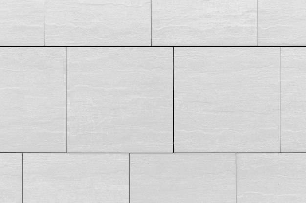 壁、背景のクローズアップに大きな灰色のタイルパターン表面