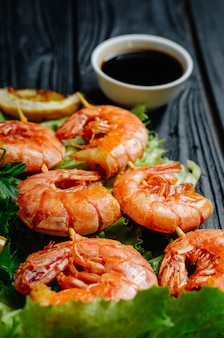 Large grilled bbq shrimp with sweet chili sauce and lemon
