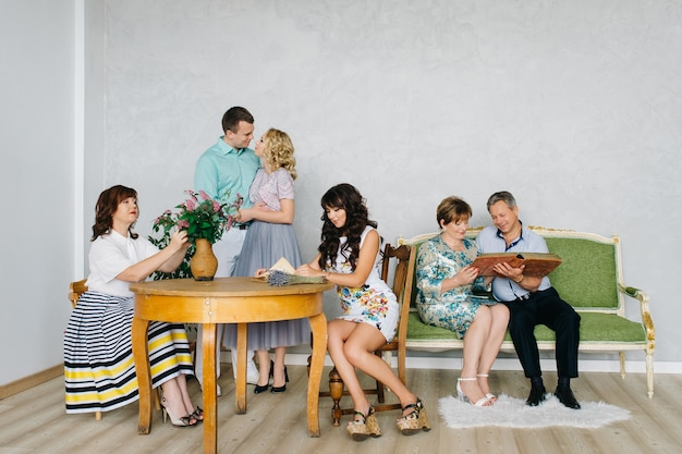 A large group of people, family classic portrait in vintage interior. the festively dressed family stays at home together.