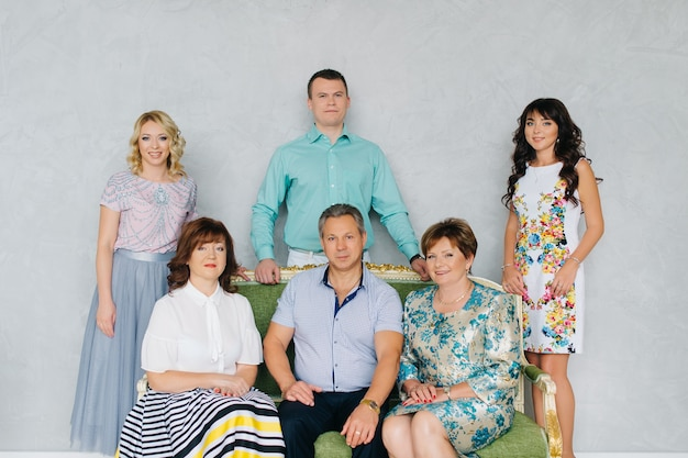 A large group of people, a large family classic portrait. the festively dressed family stays at home together.