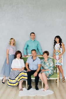 A large group of people, a large family classic portrait. the festively dressed family stays at home.