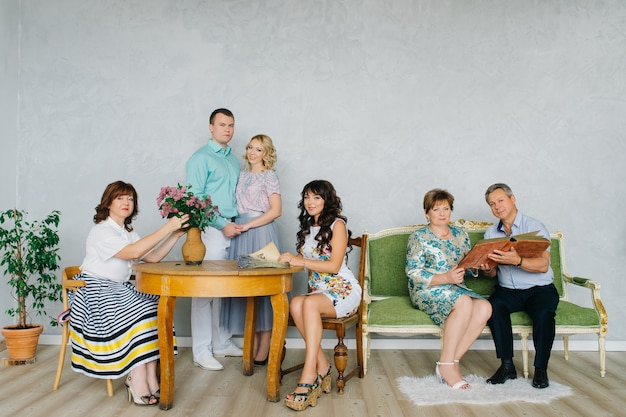 A large group of people, a large family classic portrait in vintage interior. the festively dressed family stays at home together