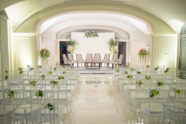 The large hotel arranged the big wedding ceremony for the bride and groom