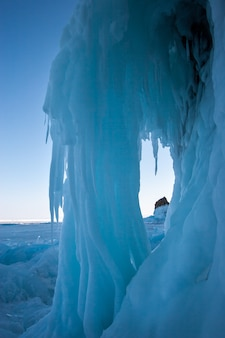 A large ice formation from icicles hanging from cliff