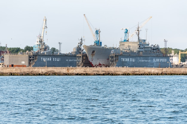 Large iron navy ships in shipyard for repair