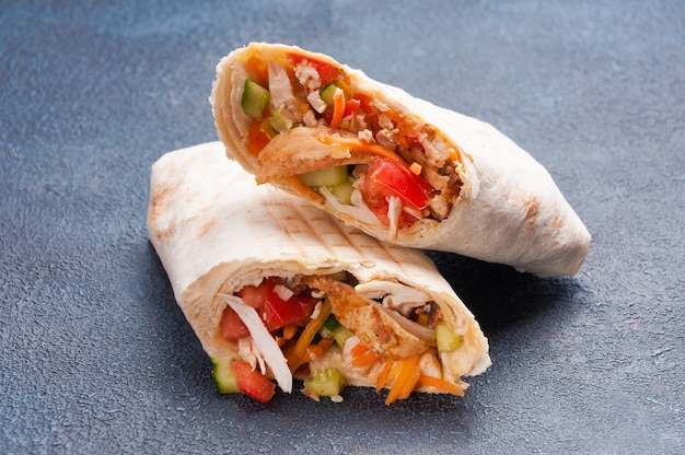 Large meat shawarma in wheat pita bread with chicken fillet