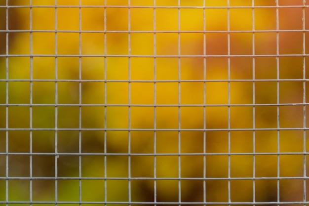 Large metal mesh. blurred background