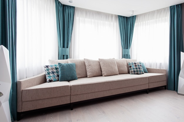 Large modern couch in the room
