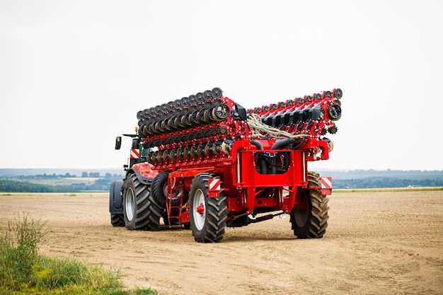 Large modern tractor for preparing the field after winter for sowing grain