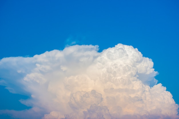 Large multi-layer white clouds against the blue sky.