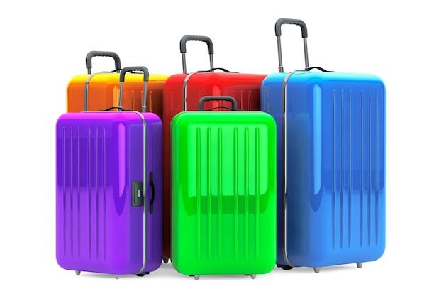Большие разноцветные чемоданы из поликарбоната на белом фоне