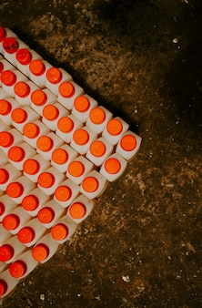 A large number of bottles with a red lid