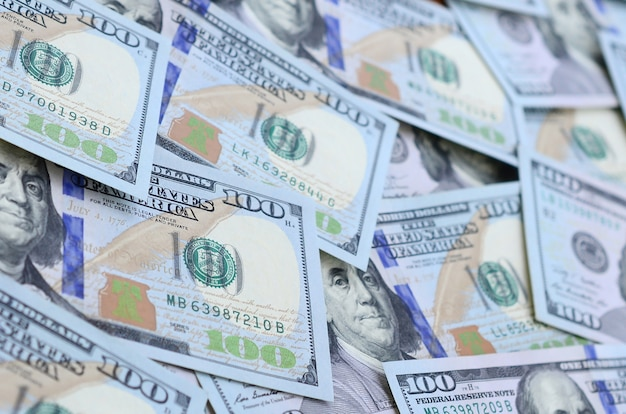A large number of us dollar bills of a new design with a blue stripe in the middle.