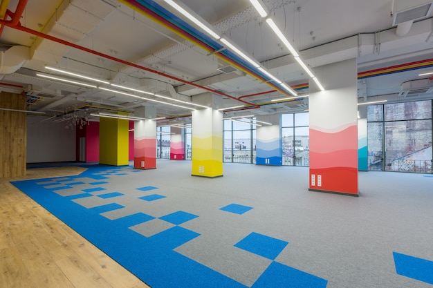 Large office center in a modern style with colored walls unfurnished