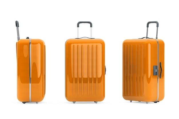 Большие оранжевые чемоданы из поликарбоната на белом фоне