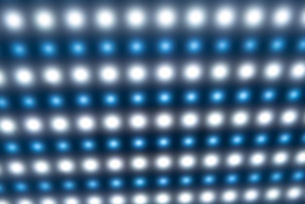 焦点がぼけた明るい冷たいぼやけたライトを備えた大きなパネル