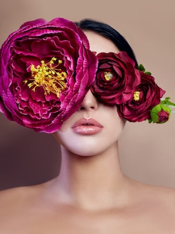 Large peonies near a woman face art fashion flower