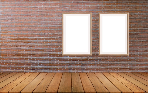 Large picture frames mounted on a red brick wall with wooden floors