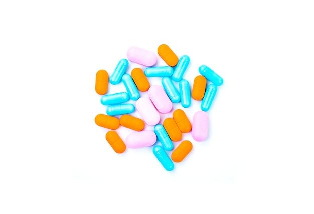 Large pills close up on white isolated background