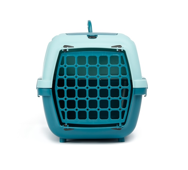 Large plastic carrier cage for cats and dogs on white background, close up