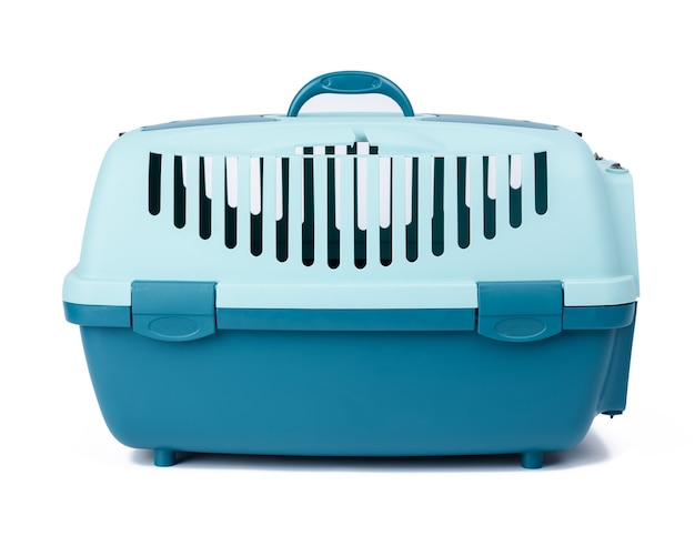 Large plastic carrier cage for cats and dogs on white background