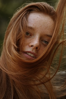 Large portrait of a red-haired girl with freckles