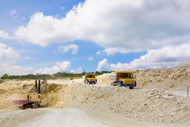 A large quarry dump truck loaded with rock