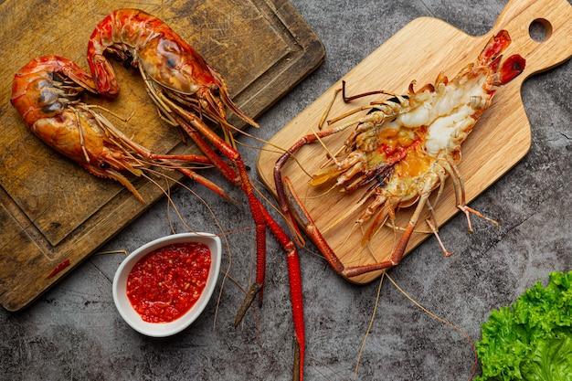 Large river prawns grilled and ready to eat decorated with beautiful side dishes.