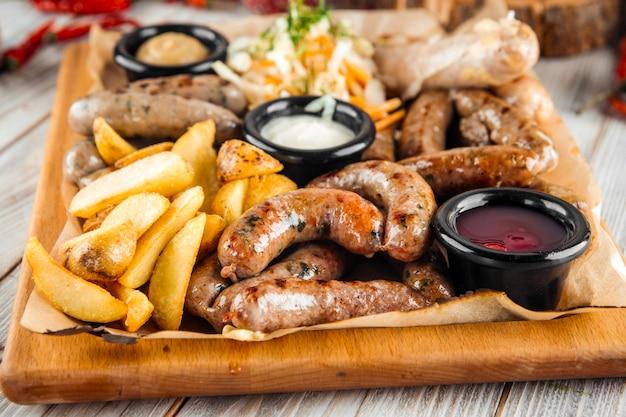 Large sausage platter sauerkraut potatoes sauce