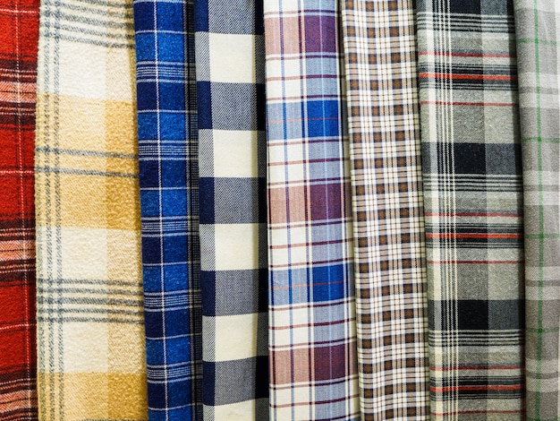 A large selection of bright plaid fabrics in the fabric store.