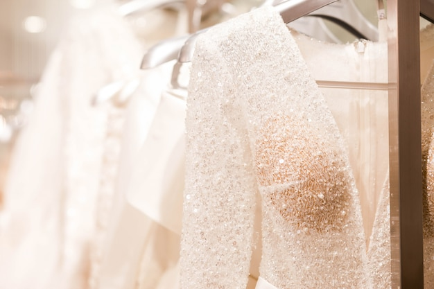 Large selection of dresses in the wedding salon.
