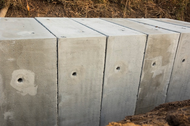 Large size square concrete manholes are  installed at construction site ; for draining storm water of main road ; civil constrution background
