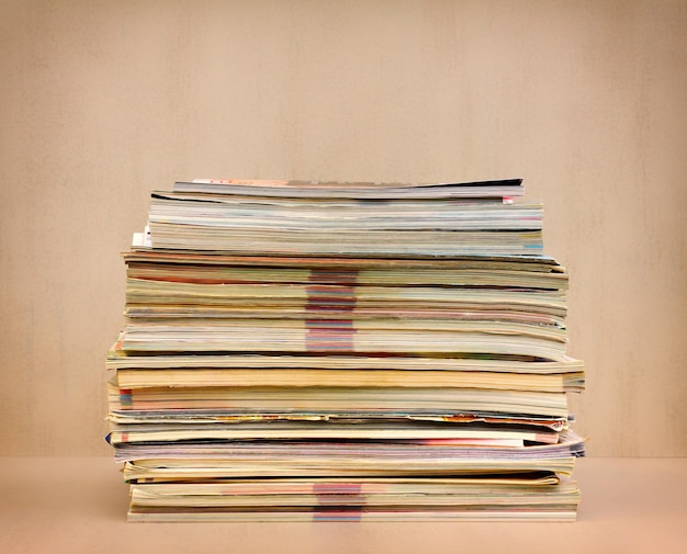 A large stack of magazines close up
