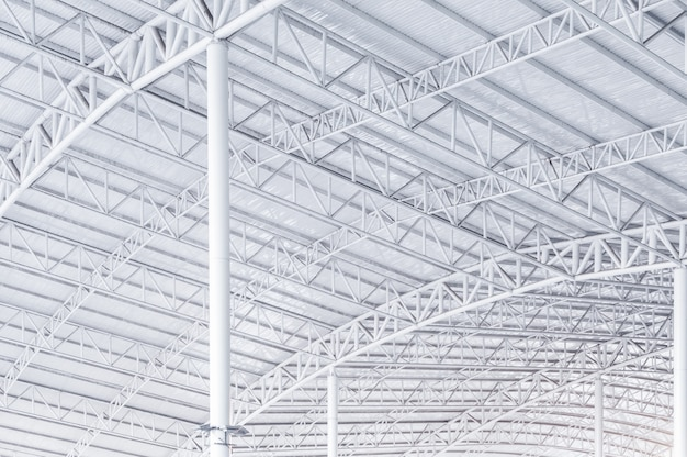 Large steel structure truss, roof frame and metal sheet in building construction site
