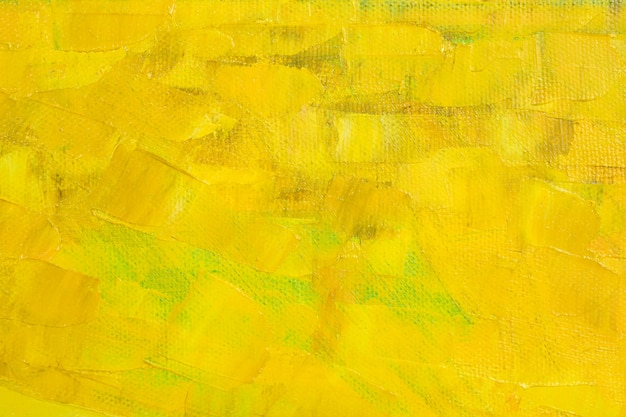 Large strokes of various shades of yellow oil paint on the surface of the canvas.