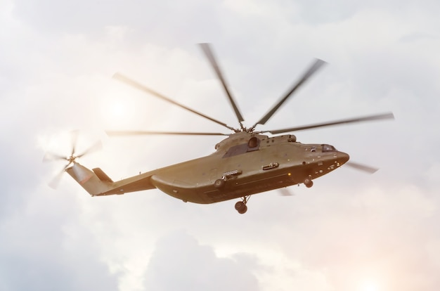 Large transport cargo helicopter is flying in the sky.
