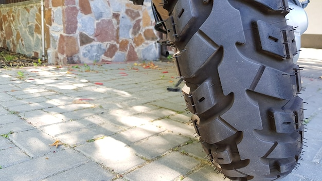 Large tread wheel motocross motorcycle close-up for travel.