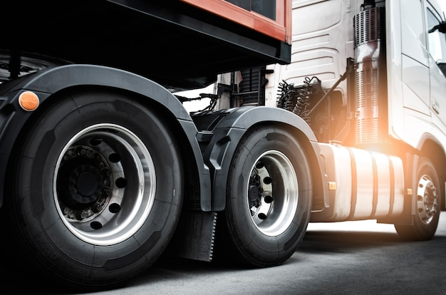 Large a truck wheels of semi truck. road freight cargo shipment.