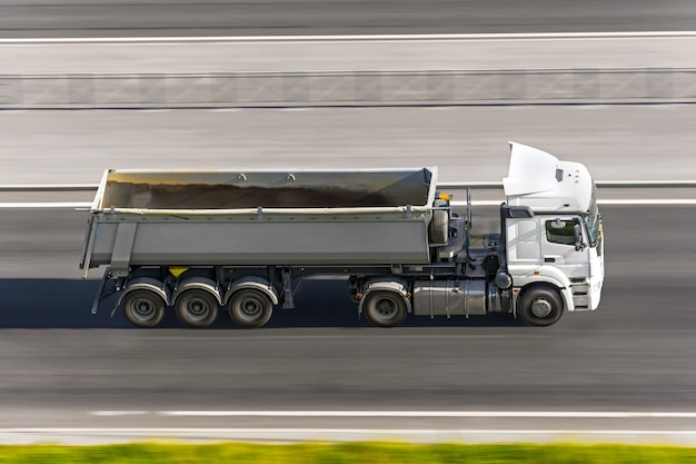 Large truck with trailer driving on the highway aerial view