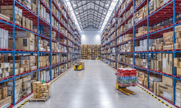Large warehouse full of goods and with lifting equipment