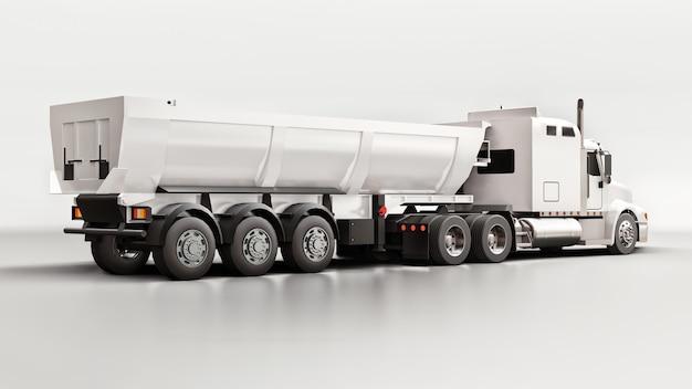 灰色のばら積み貨物を輸送するためのトレーラータイプのダンプトラックを備えた大型の白いアメリカのトラック