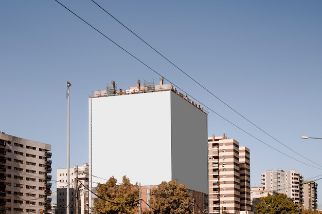 Large white blank billboard on the building in the city