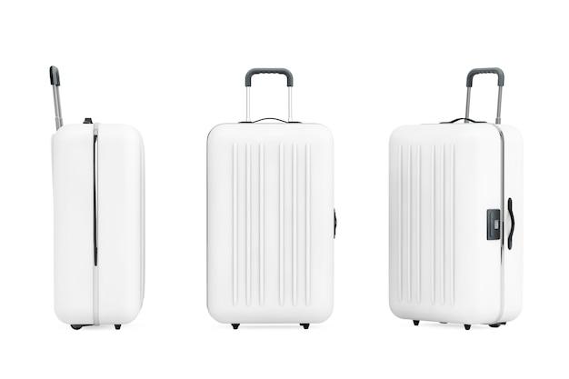 Большие белые чемоданы из поликарбоната на белом фоне