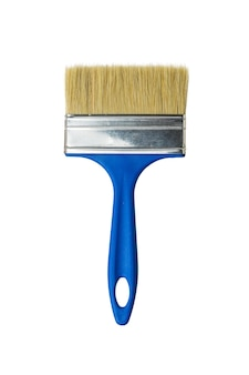 Large wide brush with blue handle isolated on white wall. materials for painting.