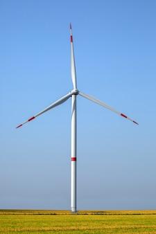 Large wind turbine against blue sky