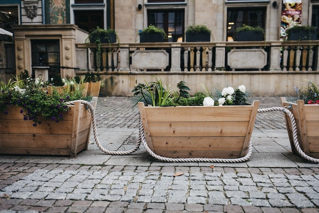 Large wooden boxes with flowers and plants in a european city